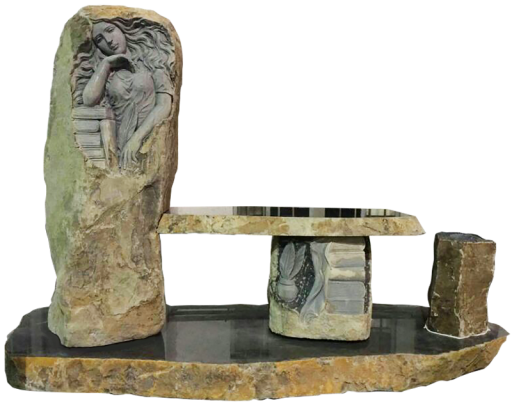 Rustic boulder with sculpted carving and cremation chambers